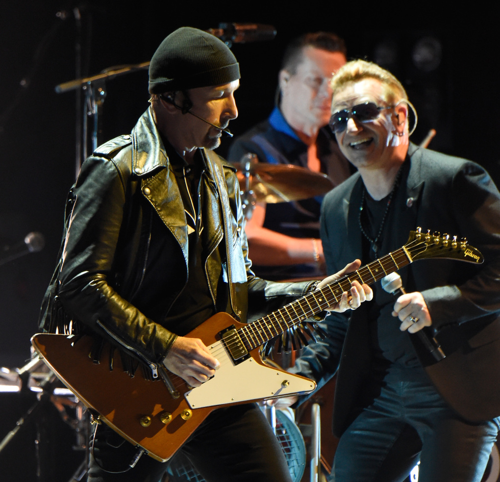 VANCOUVER, BC - MAY 14:  Musicians The Edge  (L) and Bono of U2 perform onstage during the U2 iNNOCENCE + eXPERIENCE tour opener in Vancouver at Rogers Arena on May 14, 2015 in Vancouver, Canada.  (Photo by Kevin Mazur/WireImage)