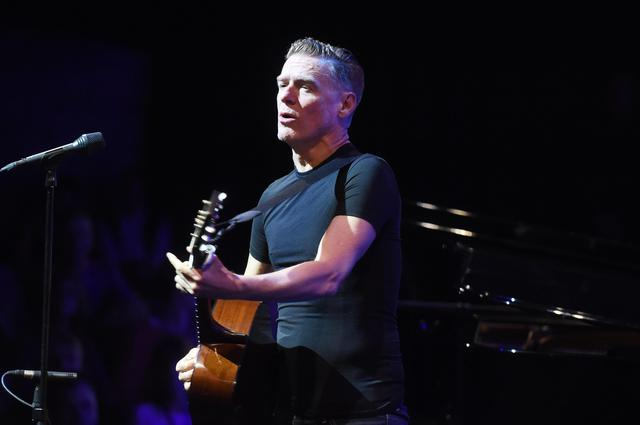 epa04977051 Canadian musician Bryan Adams performs at the Badisches Staatstheater in Karlsruhe, Germany, 13 October 2015. The occasion was a private concert of the radio station Radio Regenbogen.  EPA/ULI DECK